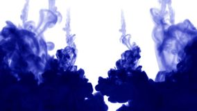 A lot of flows of isolated blue ink injects. Color spread in water , shot in slow motion. Use for inky background or. Backdrop with smoke or ink effects, alpha stock video footage