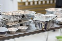 A lot of food aluminum containers. Metal forms for storing food. Forms for baking royalty free stock images