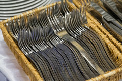 Lot of forks lies in the basket Royalty Free Stock Image