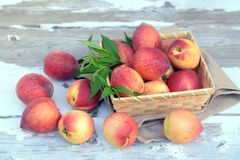 Lot of fresh peach. On the table royalty free stock photo