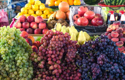 Various fruits on  market counter Royalty Free Stock Images