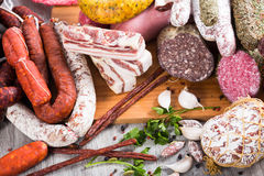 A lot of Fresh smoked sausages. A bunch of meat and sausages of various kinds Stock Photos