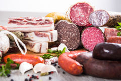 A lot of Fresh smoked sausages. Bunch of meat and sausages of various kinds Stock Photography