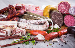 A lot of Fresh smoked sausages. Pile of delicious sausages of various kinds Royalty Free Stock Images