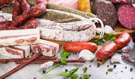 A lot of Fresh smoked sausages. Pile of delicious sausages of various kinds Stock Photo