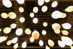 A lot of frosted lamps. Many round frosted bulbs hang on ceiling Royalty Free Stock Photography
