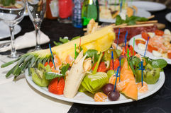 A lot of fruit on plate. A lot of fruit on the plate Stock Photo