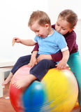 Lot of fun with gymnastic ball. Kids have a fun with the gymnastic ball Stock Photography