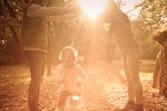 Lot of fun and laughter. Family playing together in meadow royalty free stock image