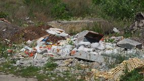 Garbage dump ecology. A lot of garbage lies on the nature. Dump surrounded by nature. Ecological problems of man stock footage