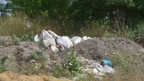 Garbage dump ecology. A lot of garbage lies on the nature. Dump surrounded by nature. Ecological problems of man stock video