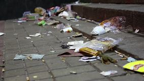 Lot of garbage lying on the street. A lot of garbage lying on the street stock video