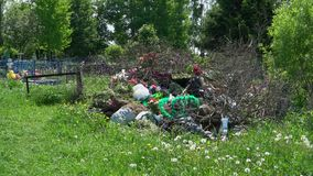 A lot of garbage with wreaths and flowers stock footage