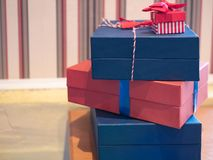 Lot of gift present card boxes on a table stock photos