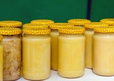A lot of glass jars with honey closeup Stock Photos