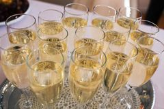 Lot of glasses with champagne during. On the party table Stock Photos