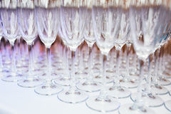 A lot of glasses of champagne on a table. In a restaurant Stock Photography