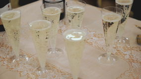 A lot of glasses with sparkling wine on table stock video