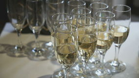 A lot of glasses with sparkling wine on table stock footage