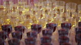 A lot of glasses with white and red wine close up.  stock video