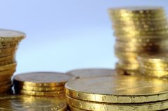 Lot of Gold coins for saving. Close up of a stock of Gold french and american coins stock photo