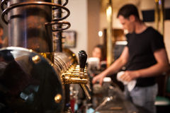 A lot of Golden beer taps at the bar Royalty Free Stock Image
