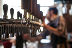 A lot of Golden beer taps at the bar Stock Photos
