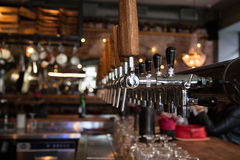 A lot of Golden beer taps at the bar Royalty Free Stock Photos