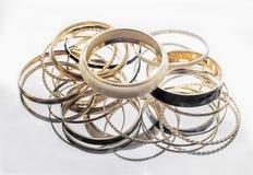 Lot of golden bracelets royalty free stock images