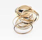 Lot of golden bracelets stock photography