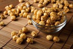 A lot of golden caramel corn. Close up Stock Photography