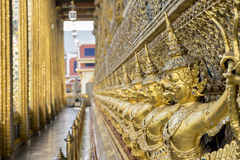 Lot of golden garuda on wall around temple Emerald Buddha, Grand Palace, Bangkok, Thailand Royalty Free Stock Images