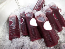 A lot  grapes juice for sale Stock Photography