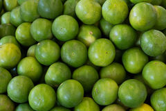 A lot of green lemon, Background. Royalty Free Stock Photos