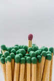 Lot of green matches and one red, leadership, light background Stock Photo