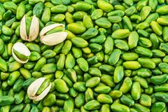 Lot of green pistachio nuts. Food background. stock photography