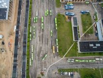 Trolley and bus depot in Kaunas, Lithuania. Aerial view. A lot of green trolley from above. Aerial view of bus deport in Kaunas, Lithuania Royalty Free Stock Photo