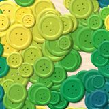 Lot of green, yellow and blue colored vintage clothing plastic buttons randomly scattered on the woody background - top view. A lot of green, yellow and blue Royalty Free Illustration