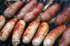 A lot of grilled sausages. Close up, barbecue Royalty Free Stock Photography