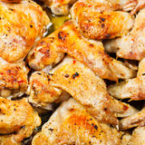 Lot of grilled spicy chicken wings Royalty Free Stock Photo