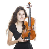 A lot of hair and a violin Stock Photo