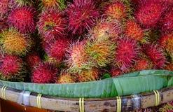 A lot of hairy rambutan fruits at a market. In Bangkok, Thailand Royalty Free Stock Images