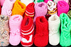 A lot of handmaded  baby shoes Royalty Free Stock Photo