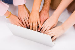Lot of hands with grey laptop. Computer on desk Royalty Free Stock Photography