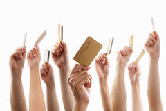 Lot of hands holding gold credit card Royalty Free Stock Photography