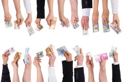 A lot of hands with important currencies. Isolated on white Stock Photos