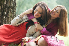 A lot of happiness. Two girls are having a lot of fun in the forest stock photography