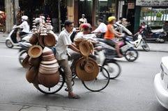 Lot of hats. HANOI, VIETNAM - JUNE 29: Unidentified hat salesman in the busy hanoi traffic on June 29, 2010 in Hanoi, Vietnam stock photo