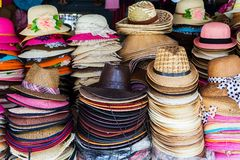 Lot of hats lie on the table Royalty Free Stock Images