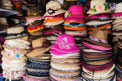 Lot of hats lie on the table Stock Image